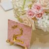 ♥Each table number was done with the print to match the inside of the invitation boxes and various gold keys were used to create the numbers on large ceramic tiles, which stood on gold easels. -Photo: Tim Otto