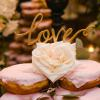 "♥This couple did the prettiest doughnut cake, and we did the topper to match the event...the sweetest gold script ""love"" topper. -Photo: Tim Otto"