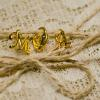 ♥The initials of the couple and a heart locket hung from the twine that wrapped the package.